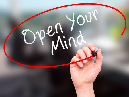 receptive: Man hand writing Open Your Mind with marker on transparent screen. Business, internet, technology concept. Isolated on office. Stock Image