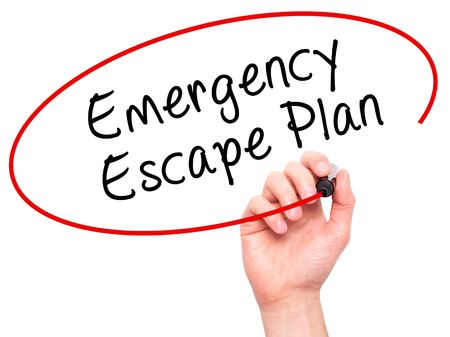 Man Hand writing Emergency Escape Plan with black marker on visual screen. Isolated on white. Business, technology, internet concept. Stock Image Stock Photo