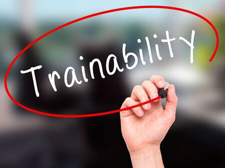 able to learn: Man Hand writing Trainability with black marker on visual screen. Isolated on office. Business, technology, internet concept. Stock Image