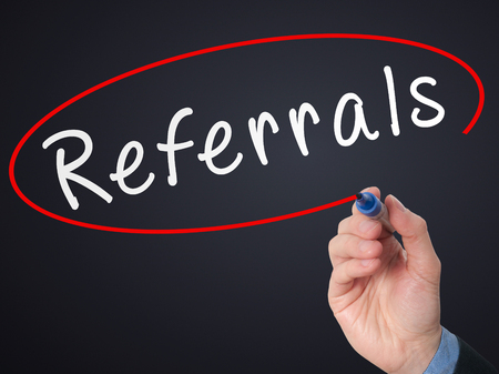 referrals: Man Hand writing Referrals with marker on virtual screen. Business, technology, internet concept. Stock Photo Stock Photo