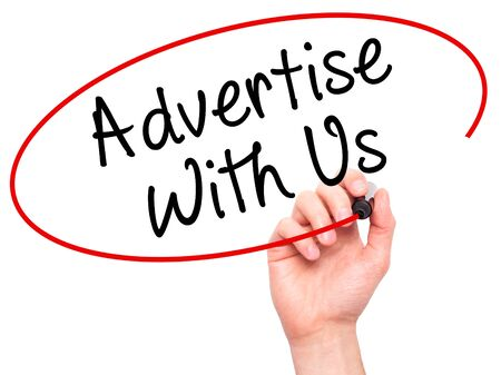 advertise: Man Hand writing Advertise With Us  with black marker on visual screen. Isolated on white. Business, technology, internet concept. Stock Image