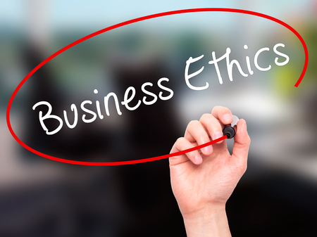 uprightness: Man Hand writing Business Ethics with black marker on visual screen. Isolated on office. Business, technology, internet concept. Stock Image
