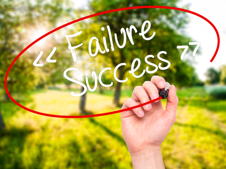 persist: Man Hand writing Failure Success with black marker on visual screen. Isolated on background. Business, technology, internet concept. Stock Photo