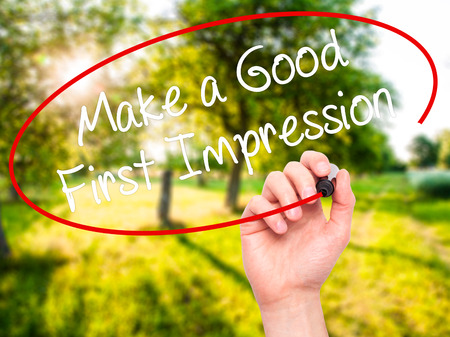 Man Hand writing Make a Good First Impression with black marker on visual screen. Isolated on background. Business, technology, internet concept. Stock Photo Stock Photo