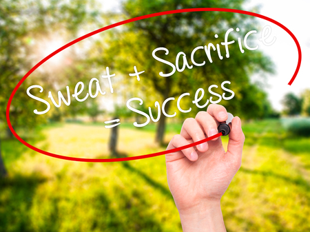 sacrificio: Man Hand writing Sweat + Sacrifice = Success with black marker on visual screen. Isolated on nature. Business, technology, internet concept. Stock Photo