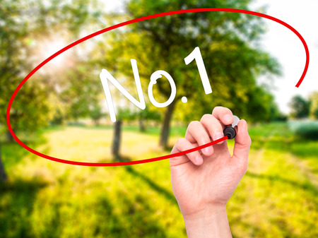 no1: Man Hand writing No.1 with black marker on visual screen. Isolated on nature. Business, technology, internet concept. Stock Photo Stock Photo