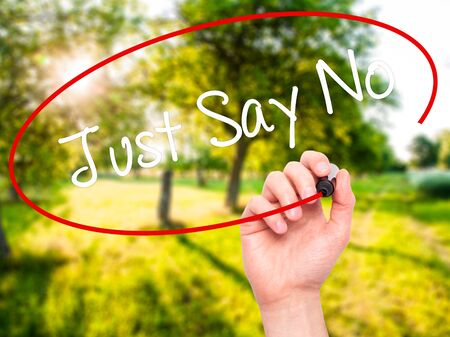 demonstrator: Man Hand writing Just Say No with black marker on visual screen. Isolated on nature. Business, technology, internet concept. Stock Photo Stock Photo