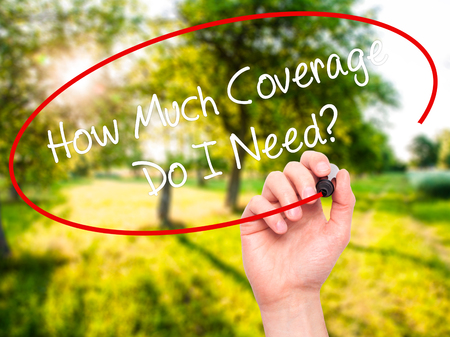 coverage: Man Hand writing How Much Coverage Do I Need? with black marker on visual screen. Isolated on background. Business, technology, internet concept. Stock Photo