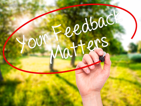 soliciting: Man Hand writing Your Feedback Matters with black marker on visual screen. Isolated on nature. Business, technology, internet concept. Stock Photo Stock Photo