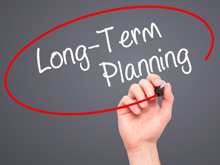ltc: Man Hand writing  Long-Term Planning with black marker on visual screen. Isolated on background. Business, technology, internet concept. Stock Photo Stock Photo
