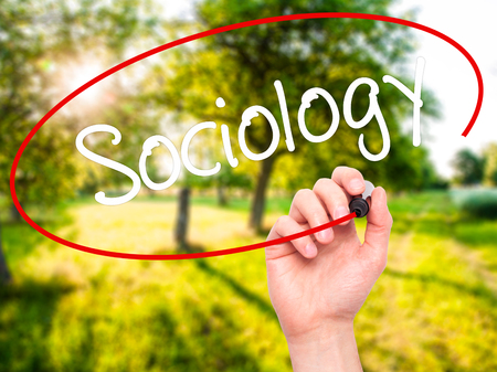 epistemological: Man Hand writing Sociology  with black marker on visual screen. Isolated on background. Business, technology, internet concept. Stock Photo