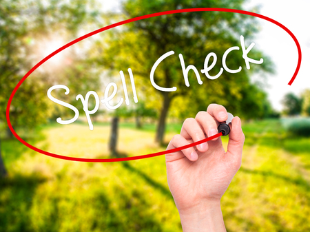grammatical: Man Hand writing Spell Check  with black marker on visual screen. Isolated on nature. Business, technology, internet concept.
