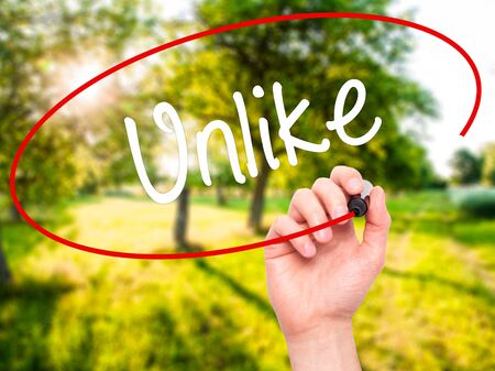 unlike: Man Hand writing Unlike with black marker on visual screen. Isolated on background. Business, technology, internet concept. Stock Photo Stock Photo