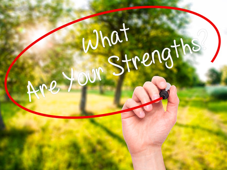 firmeza: Man Hand writing What Are Your Strengths? with black marker on visual screen. Isolated on nature. Business, technology, internet concept. Stock Photo Foto de archivo