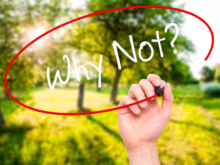 why not: Man Hand writing Why Not? with black marker on visual screen. Isolated on nature. Business, technology, internet concept. Stock Photo