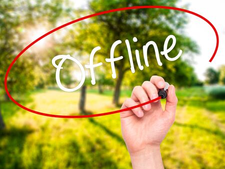 tumblr: Man Hand writing Offline  with black marker on visual screen. Isolated on nature. Business, technology, internet concept. Stock Photo Stock Photo