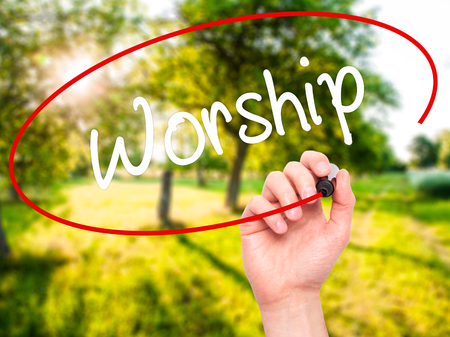 worshipper: Man Hand writing Worship with black marker on visual screen. Isolated on nature. Business, technology, internet concept. Stock Photo
