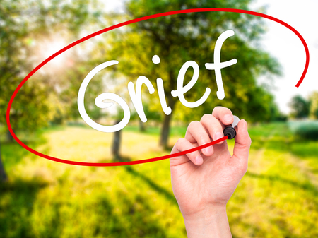 hassle: Man Hand writing Grief with black marker on visual screen. Isolated on background. Business, technology, internet concept. Stock Photo