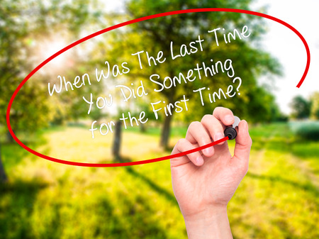 promptness: Man Hand writing When Was The Last Time You Did Something for the First Time? with black marker on visual screen. Isolated on nature. Business, technology, internet concept. Stock Photo Stock Photo