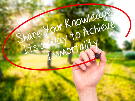 immortality: Man Hand writing Share Your Knowledge. Its a Way to Achieve Immortality with black marker on visual screen. Isolated on nature. Business, technology, internet concept. Stock Photo Stock Photo