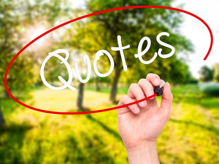 stimulus: Man Hand writing Quotes  with black marker on visual screen. Isolated on background. Business, technology, internet concept. Stock Photo Stock Photo