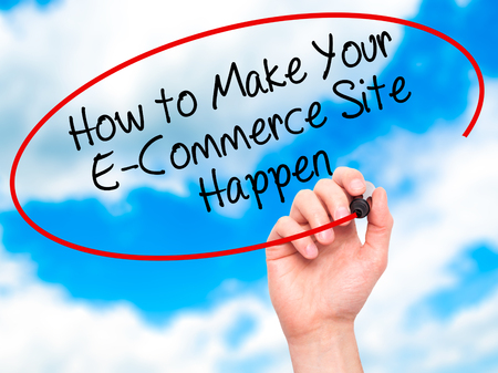 e retailers: Man Hand writing How to Make Your E-Commerce Site Happen with black marker on visual screen. Isolated on background. Business, technology, internet concept. Stock Photo