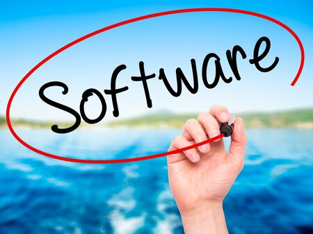 Man Hand writing Software  with black marker on visual screen. Isolated on background. Business, technology, internet concept. Stock Photo