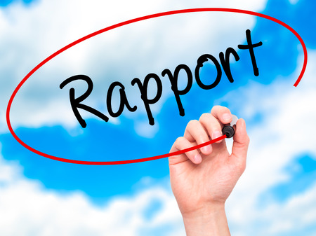 rapport: Man Hand writing Rapport with black marker on visual screen. Isolated on sky. Business, technology, internet concept. Stock Photo Stock Photo