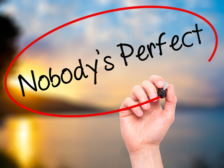 self conceit: Man Hand writing Nobodys Perfect with black marker on visual screen. Isolated on background. Business, technology, internet concept. Stock Photo