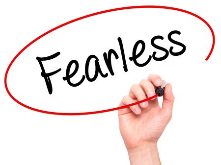 unafraid: Man Hand writing Fearless  with black marker on visual screen. Isolated on background. Business, technology, internet concept. Stock Photo Stock Photo
