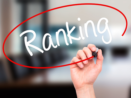 meta analysis: Man Hand writing Ranking with black marker on visual screen. Isolated on office. Business, technology, internet concept. Stock Photo Stock Photo