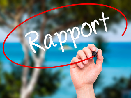 rapport: Man Hand writing Rapport with black marker on visual screen. Isolated on nature. Business, technology, internet concept. Stock Photo Stock Photo