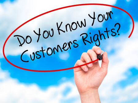 consumer rights: Man Hand writing Do You Know Your Customers Rights? with black marker on visual screen. Isolated on background. Business, technology, internet concept. Stock Photo