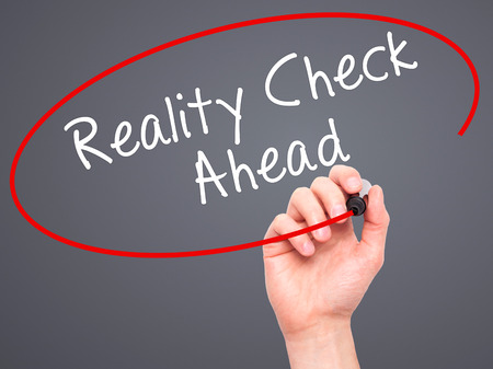 business skeptical: Man Hand writing Reality Check Ahead with black marker on visual screen. Isolated on grey. Business, technology, internet concept. Stock Photo Stock Photo