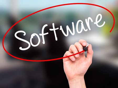 operand: Man Hand writing Software  with black marker on visual screen. Isolated on background. Business, technology, internet concept. Stock Photo