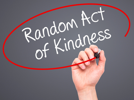 helpfulness: Man Hand writing Random Act of Kindness with black marker on visual screen. Isolated on grey. Business, technology, internet concept. Stock Photo Stock Photo