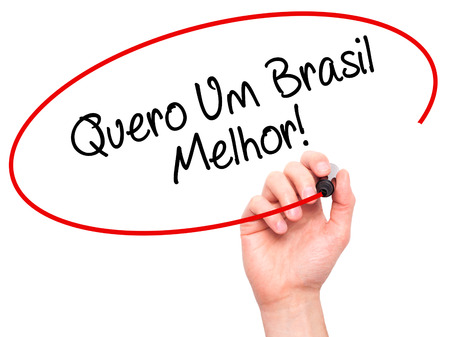 protestors: Man Hand writing Quero Um Brasil Melhor!  ( I want a Better Brazil in Portuguese)with black marker on visual screen. Isolated on white. Business, technology, internet concept. Stock Photo