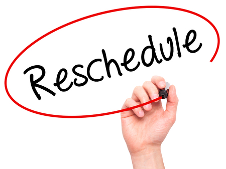 Man Hand writing Reschedule  with black marker on visual screen. Isolated on background. Business, technology, internet concept. Stock Photo