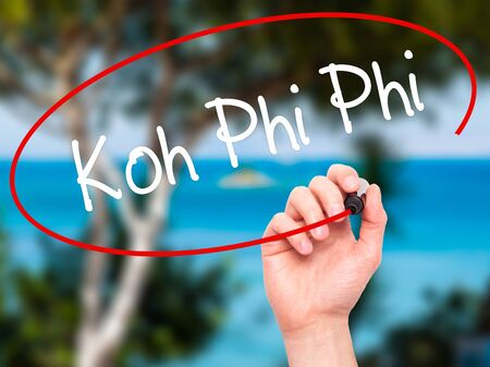 phi phi: Man Hand writing Koh Phi Phi with black marker on visual screen. Isolated on background. Business, technology, internet concept. Stock Photo