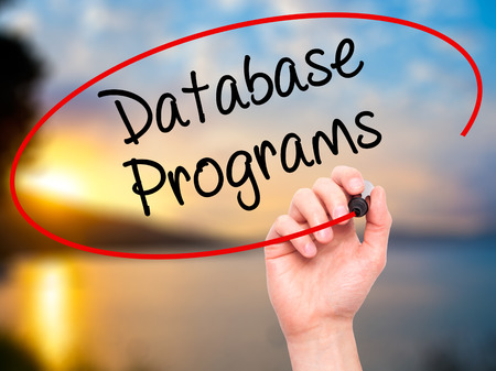 syntax: Man Hand writing Database Programs with black marker on visual screen. Isolated on background. Business, technology, internet concept. Stock Photo Stock Photo