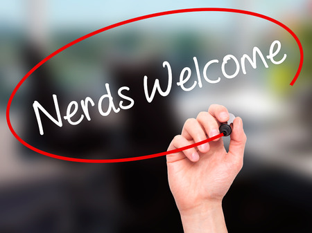 scholarly: Man Hand writing Nerds Welcome with black marker on visual screen. Isolated on background. Business, technology, internet concept. Stock Photo