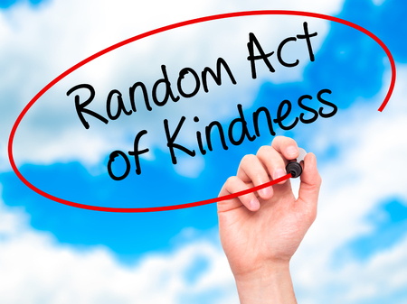helpfulness: Man Hand writing Random Act of Kindness with black marker on visual screen. Isolated on sky. Business, technology, internet concept. Stock Photo Stock Photo