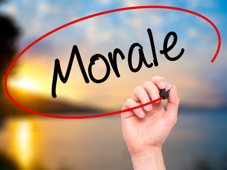 morale: Man Hand writing Morale with black marker on visual screen. Isolated on nature. Business, technology, internet concept. Stock Photo Stock Photo