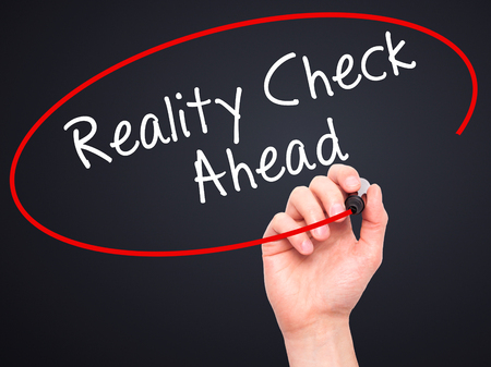 business skeptical: Man Hand writing Reality Check Ahead with black marker on visual screen. Isolated on black. Business, technology, internet concept. Stock Photo Stock Photo