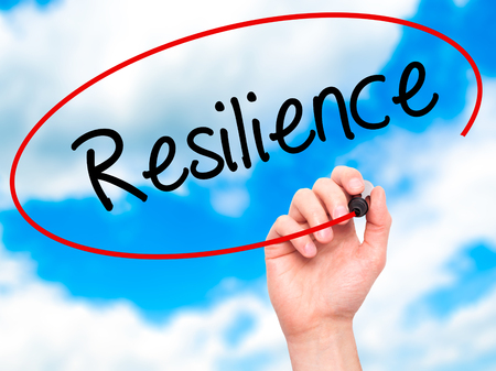 resilience: Man Hand writing Resilience with black marker on visual screen. Isolated on sky. Business, technology, internet concept. Stock Photo Stock Photo