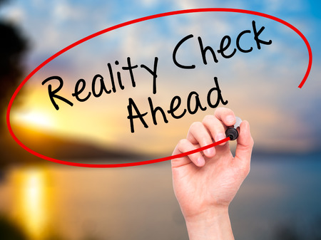 business skeptical: Man Hand writing Reality Check Ahead with black marker on visual screen. Isolated on nature. Business, technology, internet concept. Stock Photo Stock Photo