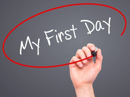 first year student: Man Hand writing My First Day with black marker on visual screen. Isolated on grey. Business, technology, internet concept.