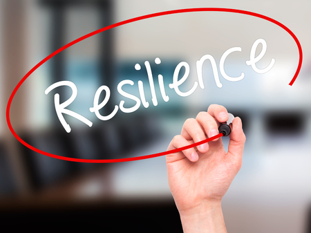 resilience: Man Hand writing Resilience with black marker on visual screen. Isolated on office. Business, technology, internet concept. Stock Photo Stock Photo