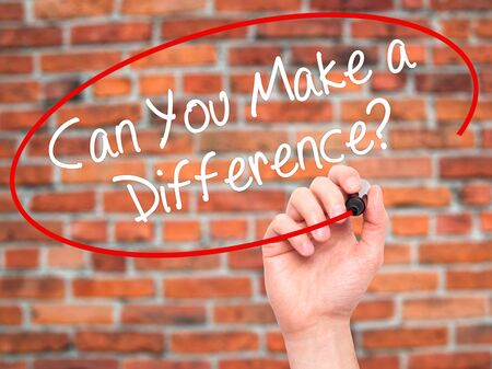 difference: Man Hand writing Can You Make a Difference? with black marker on visual screen. Isolated on background. Business, technology, internet concept. Stock Photo Stock Photo