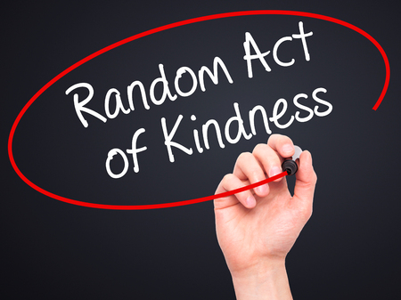 helpfulness: Man Hand writing Random Act of Kindness with black marker on visual screen. Isolated on black. Business, technology, internet concept. Stock Photo Stock Photo